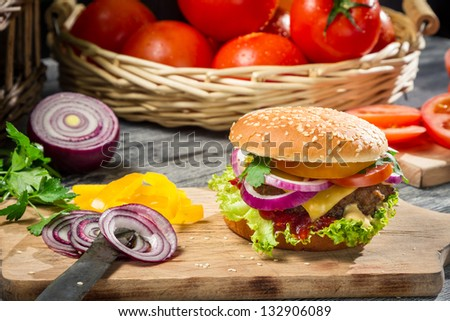 Closeup of burger made �¢??�¢??from fresh vegetables and beaf