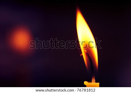 Closeup of burning candle - stock photo
