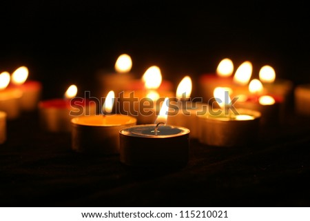 Closeup of burning candles outside in winter time