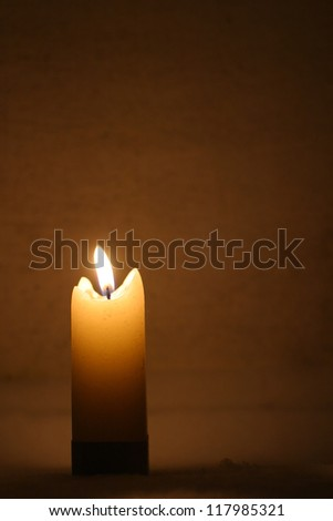 Closeup of burning candles outside in winter time - stock photo