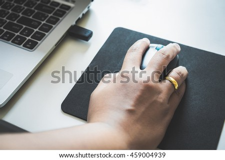 Closeup of business man hand working on computer mouse. - stock photo