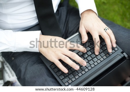 Closeup of business man hands working on laptop. - stock photo