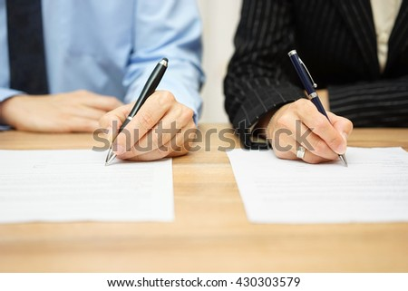 closeup of Business partners  signing new deal