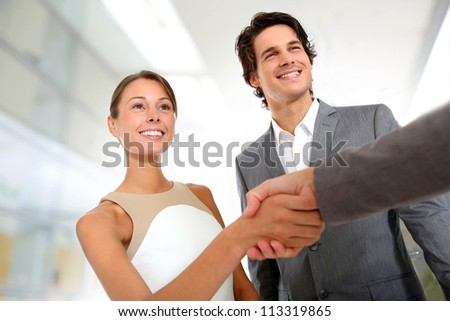Closeup of business partnership handshake - stock photo