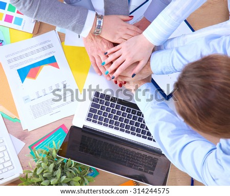 Closeup of business people's hands making a pile  - stock photo