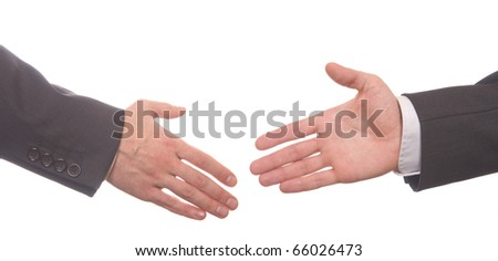 Closeup of business people shaking hands over white - stock photo