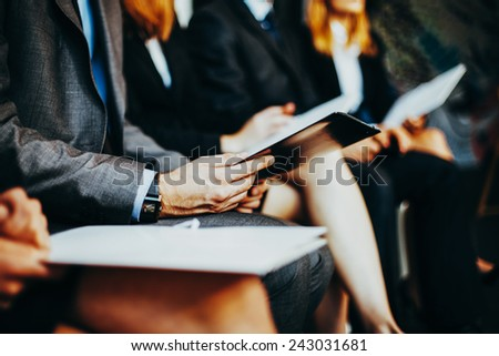Closeup of business people waiting for interview - stock photo