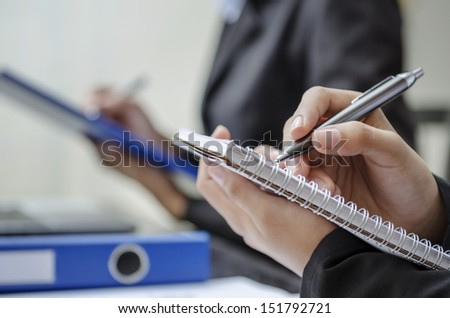 Closeup of business people writing - stock photo