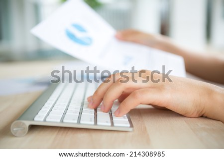 Closeup of business woman hand typing on keyboard