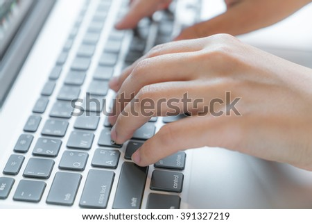 Closeup of business woman hand typing on laptop keyboard - stock photo