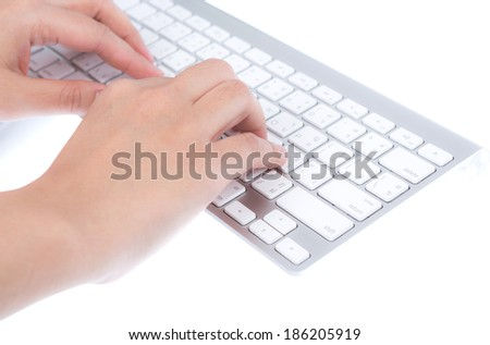 Closeup of business woman hand typing on laptop keyboard with mouse
