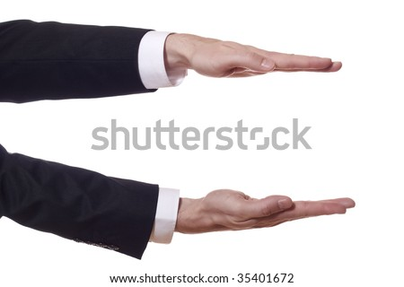 closeup of businessman arms who shows the height - stock photo