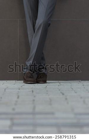 Closeup of businessman legs on the street - stock photo
