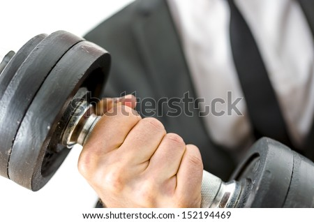 Closeup of businessman lifting heavy weights. Concept of determination in business. - stock photo