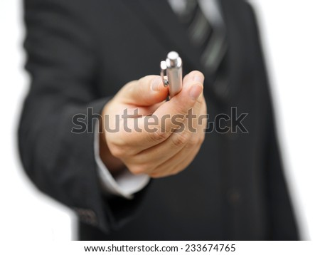 Closeup of businessman offering a pen - stock photo
