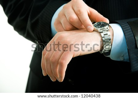 Closeup of businessman's hand with watch on it while he checking the time - stock photo