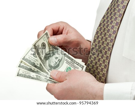 Closeup of businessman's hands counting dollar banknotes; isolated over white background