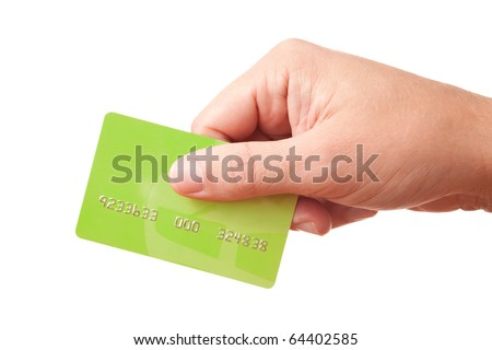 Closeup of businessman's or customer's hand holding unidentified green plastic credit or debit card, passing it to somebody to make payment - stock photo