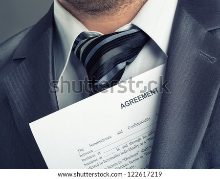 Closeup of businessman with agreement - stock photo