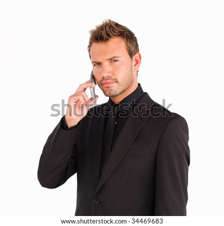 Closeup of businessman with cell phone looking serious at the camera