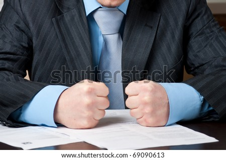 closeup of  businessman with clenched fists - stock photo