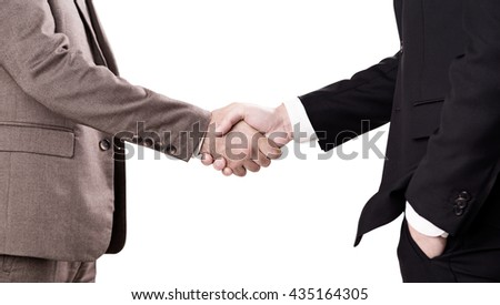 Closeup of businessmen in suits isolated on white background shaking hands - stock photo