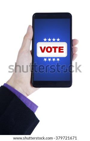 Closeup of businessperson hand holding smartphone with vote button on the screen, isolated on white background - stock photo