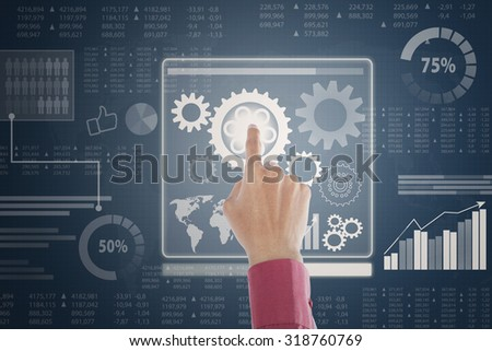 Closeup of businessperson hand touching screen to control and access financial data - stock photo