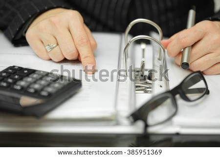 Closeup Of Businesswoman  Hands analyzing financial data - stock photo