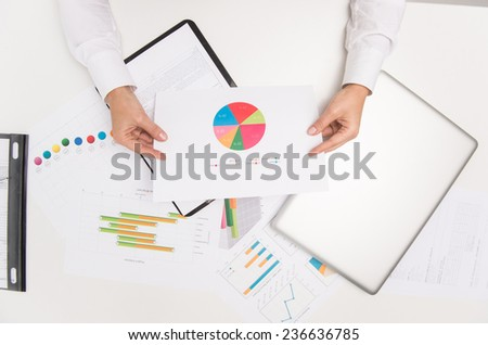 Closeup of businesswoman hands holding paper. Close-up of businesswoman hand looking at meeting