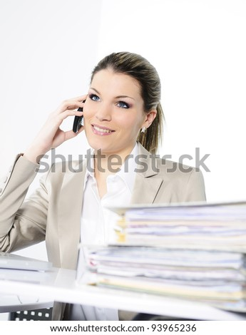Closeup of businesswoman in the office talking on the phone - stock photo