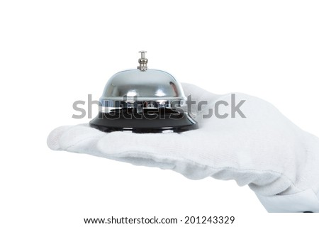 Closeup of butler's hand with service bell over white background - stock photo