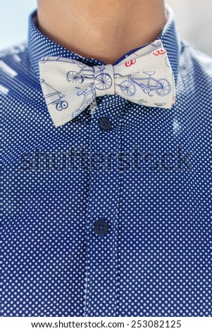closeup of butterfly tie and blue shirt on caucasian man - stock photo