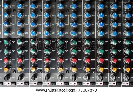 Closeup of buttons of a studio mixer - stock photo
