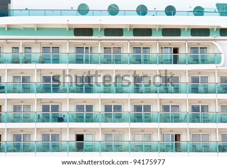 Closeup of cabin balconies of an ocean liner or cruise ship.
