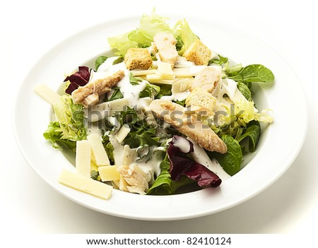 closeup of caesar salad on a white background