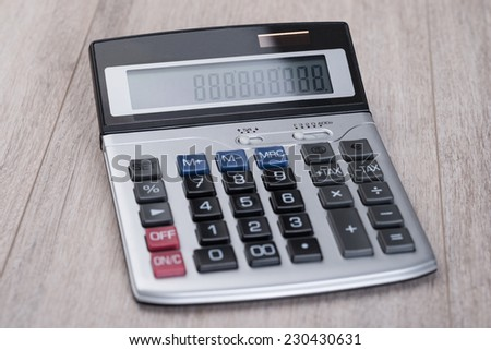 Closeup of calculator on wooden table. Tax concept - stock photo