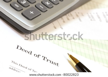 Closeup of calculator, pen and Deed of Trust form..