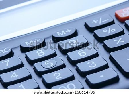 Closeup of calculator. Tinted photo - stock photo