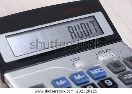 Closeup of calculator with Audit on display - stock photo