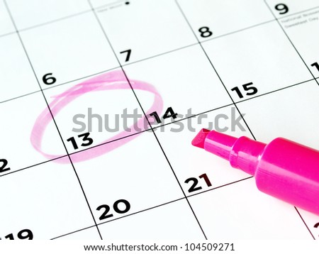 Closeup of calendar page with marked important day