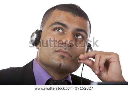 Closeup of call center agent, holding microphone and thinks about a problem. Isolated on white. - stock photo