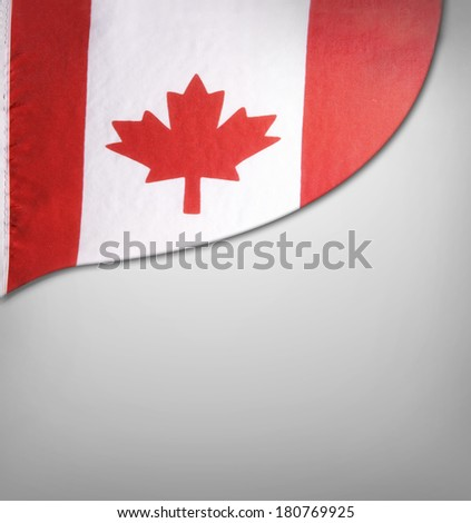 Closeup of Canadian flag on plain background - stock photo