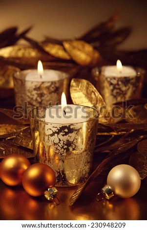 Closeup of candles lit with a sparkling gold theme - stock photo