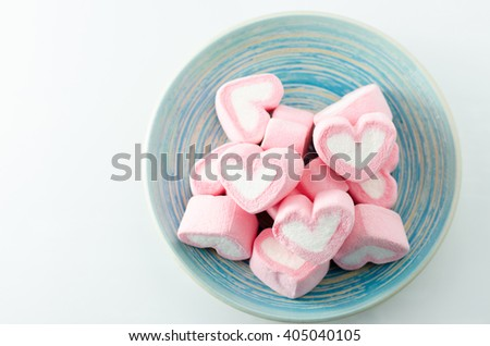 Closeup of candy Valentines hearts on White background - stock photo