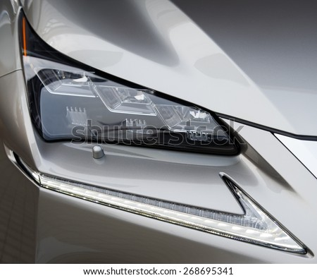 Closeup of car headlight - stock photo