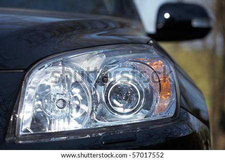 Closeup of car headlight - front view - stock photo