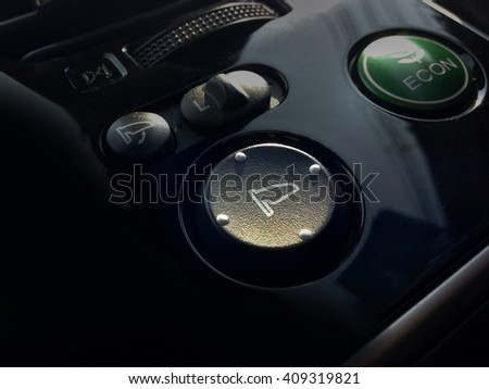 Closeup of car wing mirror control switch