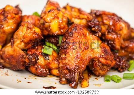 Closeup of caramelized asian chicken wings with selective focus