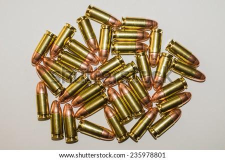 Closeup of cartridges pistols ammo on white background - stock photo